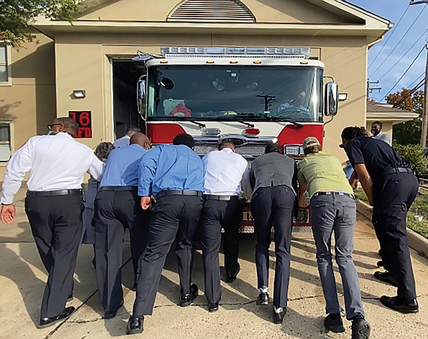 """City leaders and community members take part in a """"Push In"""" ceremony to put a new fire engine in service at Fire Station 16. Location: 3901 Cham- berlayne Ave. Among the participants at the Oct. 9 event are Mayor Levar M. Stoney and Richmond Fire Chief Melvin Carter. Four other stations around the city also are planning similar ceremonies when their new trucks arrive."""