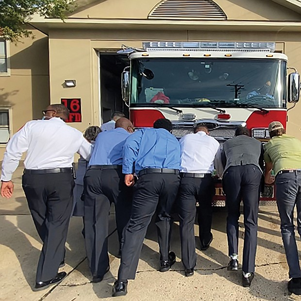 "City leaders and community members take part in a ""Push In"" ceremony to put a new fire engine in service at Fire Station 16. Location: 3901 Cham- berlayne Ave. Among the participants at the Oct. 9 event are Mayor Levar M. Stoney and Richmond Fire Chief Melvin Carter. Four other stations around the city also are planning similar ceremonies when their new trucks arrive."
