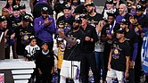 Los Angeles Lakers LeBron James holds his fourth Finals MVP award as he celebrates the Lakers' win Sunday over the Miami Heat with his teammates in Lake Buena Vista, Fla.