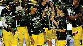 Seattle Storm guard Sue Bird shows the trophy to some of her teammates Oct. 6 after the team defeated the Las Vegas Aces to win the WNBA championship 2020, in Bradenton, Fla.