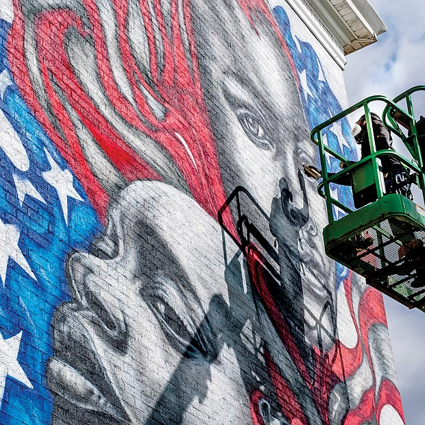 Celebrated Richmond muralist Hamilton Glass completes his latest addition to the city's streetscape — a dramatic work that features black faces infused into the traditional red, white and blue and stars of the American flag. A clear artistic statement of the message that Black Lives Matter, the mural faces the Brookland Park Boulevard side of the Richmond Urban Ministry Institute at the intersection of Chamberlayne Avenue and Brookland Park Boulevard in North Side. New murals continue to be added. On Wednesday, the city unveiled Josh Zarambo's mural tribute to the late Congressman John Lewis of Georgia at the Powhatan Community Center on Fulton Hill. And recently, another well-known muralist, Sir James Thornhill, completed a new mural with student help in the 800 block of Oliver Hill Way in Shockoe Bottom.