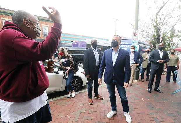 Doug Emhoff, husband of Democratic vice presidential candidate Sen. Kamala Harris, chats with Herman Baskerville, left, owner of Big Herm's Kitchen in Jackson Ward, as he picks up takeout from the 2nd Street eatery before heading to a campaign rally in Henrico County, where he joined Congresswoman Abigail Spanberger of Henrico. Mayor Levar M. Stoney, right, took the opportunity to meet with Sen. Harris' spouse in Richmond. This is Mr. Emhoff's second campaign visit to Richmond in the last 30 days.