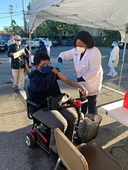 Participants at a recent flu vaccine clinic in a safe outdoor location which provides parishioners with a further sense of comfort during a trying time.
