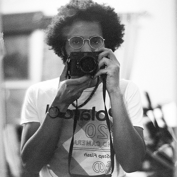 Dominick Lewis owns Photodom, a store that sells photography equipment, apparel and accessories.