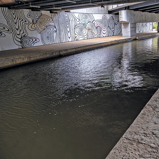 Artistic designs decorate a tunnel portion of the Canal Walk in Downtown. This section near Virginia and 14th streets is part of the James River and Kanawha Canal that dates to 1785. George Washington envisioned and surveyed the canal that tracks the James River and enabled goods to flow into and out of the city. In the 1990s, Richmond began improvements to the canal system, including the separate Haxall Canal, that had long been in disrepair. The result: A 1.25-mile walk that is open 24/7. The Canal Walk connects from around Brown's Island to the west to Shockoe Bottom and the Virginia Capital Trail to the east.