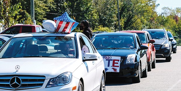 """Members of the Henrico Alumnae Chapter of Delta Sigma Theta Sorority line up last Saturday near Highland Springs High School for a """"Caravan to the Polls,"""" a get-out-the-vote event sponsored by the alumnae chapter. Voters met in their vehicles at varying neighborhood rallying points in Eastern Henrico County where they joined the Delta caravan to the early voting sites in the county."""