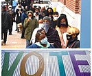Residents participate in early voting in Harlem