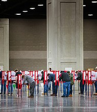 Voters stand in ballot boxes at the Kentucky Exposition Center on November 3, 2020 in Louisville, Kentucky.