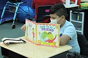 Eichelberger Elementary School fourth grade student Leonardo Hoyos reads a book during the first day of in-person learning on Monday, October 26, 2020. District 202 schools have been in full remote learning since March 2020 when the COVID-19 pandemic started. On Monday, October 26, 2020 District 202 welcomed back multi-needs students to in-person learning.