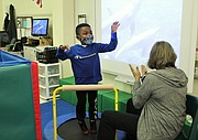 Bonnie McBeth Learning Center student Jeremiah Wiggins jumps on a mini trampoline during an occupational therapy obstacle course with occupational therapist Cheryl Lukas during the first day of in-person learning on Monday, October 26, 2020.