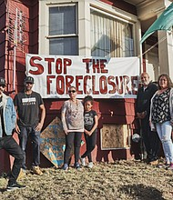 The Kinney family is pictured outside the home they were evicted from this summer on North Mississippi Avenue. The family is appealing to get the home back, claiming a sophisticated mortgage scam and foreclosure was triggered by fraud and deceit.