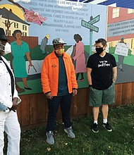 Community organizer Jackie Strong (from left), artist Daren Todd, and homeowners Collin McFadyen and Jeana Frazzini introduce Todd's new Haight Avenue Mural, a panel of five images depicting Portland Black History. The artwork along a fence line was revealed during a community dedication on Thursday at North Haight Avenue and the Going Street walkway.