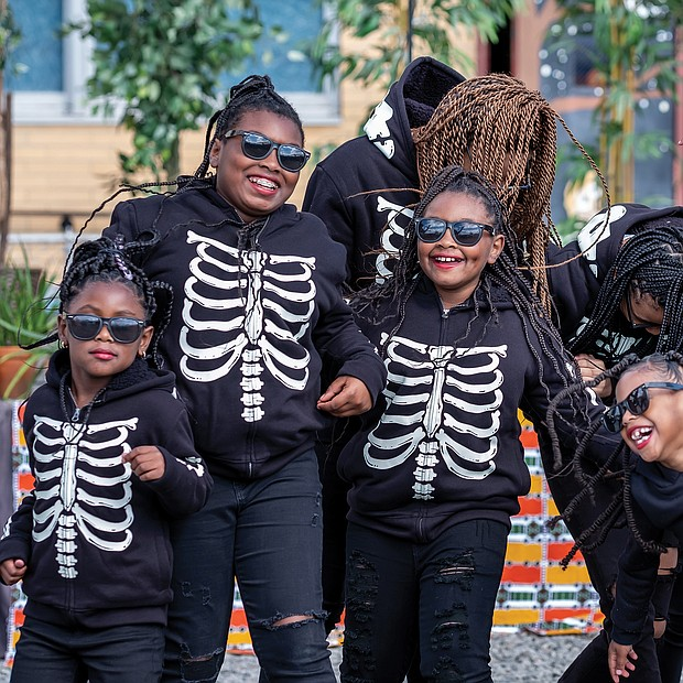 Members of the Diamonds of Essence Dancers have fun as they perform on Halloween during the Black Coalition of Change Justice Rally to Unify and Empower the black Community. The event, held in Church Hill and sponsored by a coalition of groups, had a festival atmosphere with music, dancing, food and vendors.