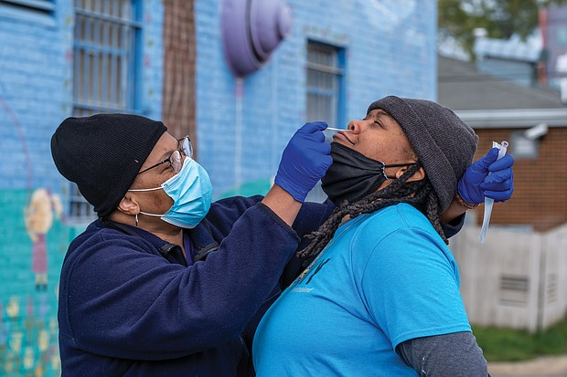 With the current global health crisis and its disproportionate impact on the Black and brown community, free COVID-19 testing also was available at the Black Coalition of Change Justice Rally to Unify and Empower the Black Community. Cherrie McLean takes a nasal swab from an attendee during the testing.
