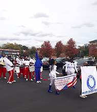 The Baltimore All-Stars Marching Unit delivers an exhibition during the senior feeding summit.