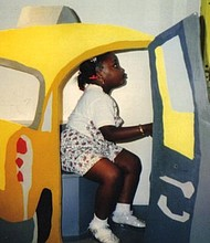 Alanah Nichole Davis as a little girl figuratively driving to the polls.