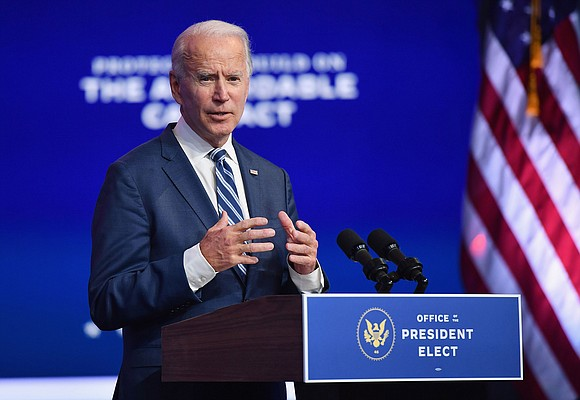 """President-elect Joe Biden urged Americans to wear a face mask Monday, saying that doing so """"is not a political statement"""" ..."""