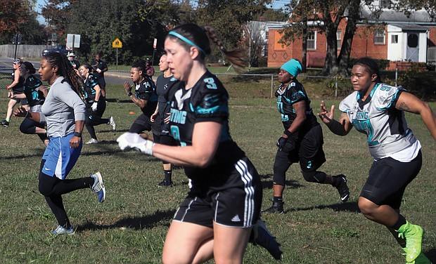 Women run through a series of drills last Saturday during tryouts for the River City Sting women's full tackle football team. The tryouts, held at Montrose Elementary School in Eastern Henrico, will continue for the next two Saturdays, with the team scheduled to begin playing in the spring.