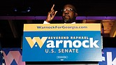 The Rev. Raphael Warnock, a Democratic candidate for the U.S. Senate, speaks Nov. 3 during a rally in Atlanta.