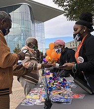 Baltimore Leadership School for Young Women Class of 2021 students greet and help inform Baltimore City voters outside of the Morgan State University polling site on Election Day.