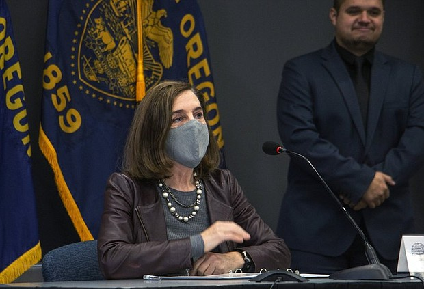 Oregon Gov. Kate Brown attends a news conference Tuesday, Nov. 10 to warn about capacity challenges facing hospitals as COVID-19 case counts continue to spike in the state. Oregon tallied 1,122 new confirmed or presumptive cases of COVID-19 on Thursday, shattering its previous record as the coronavirus continues to spread rapidly statewide. Four new deaths were also reported. (AP photo)