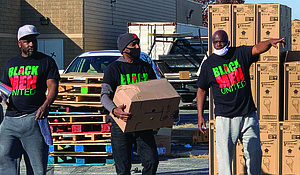 Black Men United partnered with Christmas in the Wards to provide Personal Protective Equipment as well as food during events across the city in October and early November. Photo by Tia Carol Jones