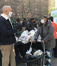 Bronx Borough President Ruben Diaz with a constituent at a food giveaway in the Bronx