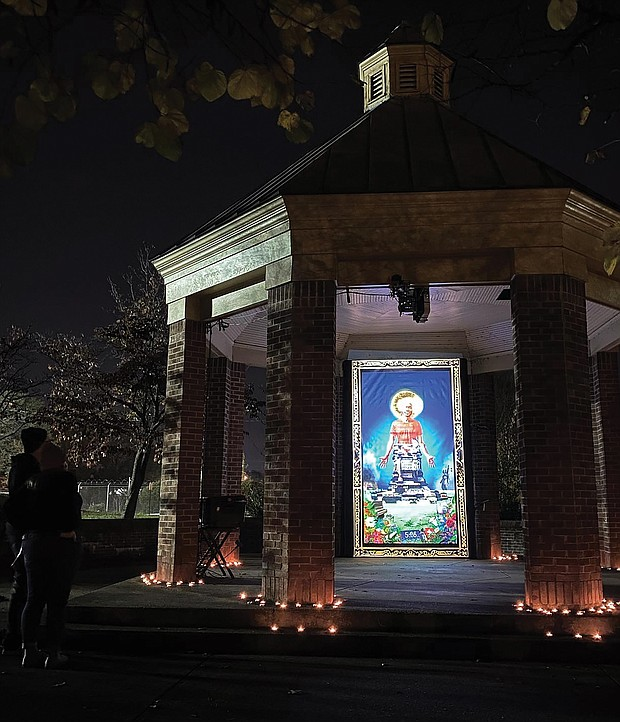 """Light and art decorate the stone and brick gazebo at Petronius Jones Park on Idlewood Avenue in the Randolph neighborhood. The display, called """"Marcus-David Peters Circle"""" and done by artists Dustin Klein, Alex Criqui, Miguel Carter-Fisher and Josh Zarambo, is just one of example of the illuminated art that was spread across the city during the InLight Richmond show that ended Sunday. The 1708 Gallery in Downtown added a new twist to the 13th edition of the artistic illumination that it sponsors. Rather than using one site as in the past, the artwork was placed in various locations around Richmond to encourage social distancing, including this small park and at the former Richmond Community Hospital building in North Side. As always, the show offered the works of a variety of Richmond area artists."""