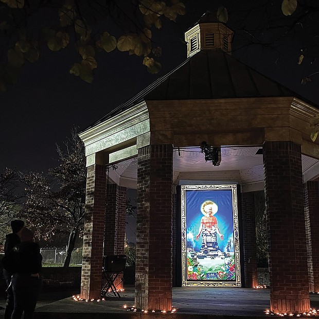 "Light and art decorate the stone and brick gazebo at Petronius Jones Park on Idlewood Avenue in the Randolph neighborhood. The display, called ""Marcus-David Peters Circle"" and done by artists Dustin Klein, Alex Criqui, Miguel Carter-Fisher and Josh Zarambo, is just one of example of the illuminated art that was spread across the city during the InLight Richmond show that ended Sunday. The 1708 Gallery in Downtown added a new twist to the 13th edition of the artistic illumination that it sponsors. Rather than using one site as in the past, the artwork was placed in various locations around Richmond to encourage social distancing, including this small park and at the former Richmond Community Hospital building in North Side. As always, the show offered the works of a variety of Richmond area artists."
