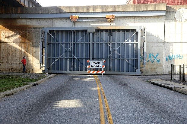 On Thursday, Nov. 12, as the river began to rise quickly, the city Department of Public Utilities closed two gates in the floodwall — at Dock Street and at Brander Street — for the first time since 1999 to protect Shockoe Bottom.