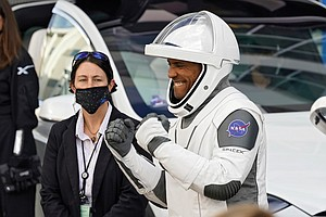 NASA astronaut Victor Glover reacts last Sunday to family members as he leaves the Operations and Checkout Building at the Kennedy Space Center with fellow crew members for a six-month mission to the International Space Station.