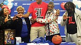 John Marshall High School basketball standout Roosevelt Wheeler, who at 6-foot-10 is one of the most recruited high school players in the nation, announces his decision to attend the University of Louisville on Monday in the North Side school's gym. Joining him for the announcement celebration are, from left, his sister, Courtney Ingram of Atlanta; his mom, Deborah Davis of Richmond; his father, Roosevelt Wheeler Sr. of Atlanta; and his brother, C.J. Smith of Atlanta.