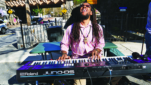 Aaron Hill performs at the corner of Maryland Avenue and Main Street in Ellicott City with Street Serenades on November 8, 2020.