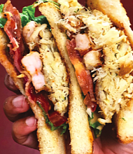 The Urban Oyster's Hook, Line & Sinker Sandwich. Created by Norton's father, the sandwich is comprised of fried cod, shrimp and oysters with let- tuce, tomato, bacon, and special sauce.