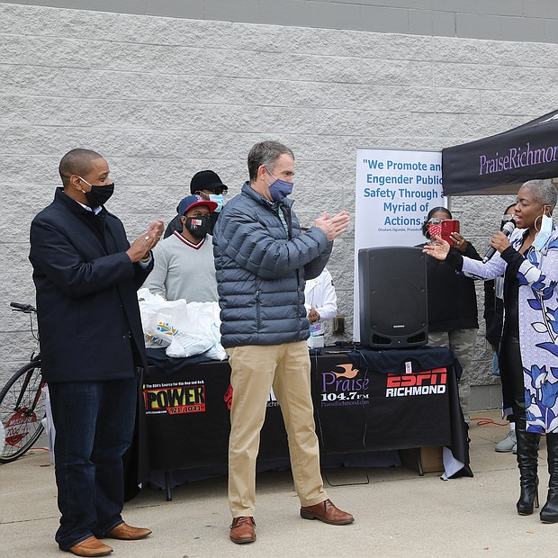 """Radio personality """"Miss Community"""" Clovia Lawrence of Urban One gets a big surprise last Saturday when Gov. Ralph S. Northam, center, and Lt. Gov. Justin E. Fairfax, left, show up during her 17th Annual Toy Drive outside the Walmart store on Sheila Lane in South Side and present her with proclamations honoring her 30 years of community work. The surprise presentation was organized by Christopher J. Woody of the Woody Foundation. Ms. Lawrence started the toy drive in 2004 to assist working families who couldn't afford gifts for their children during the holiday season. Since then, more than 60,000 donated toys have been given to Richmond area families. Even as she was being honored, Ms. Lawrence was busy encouraging shoppers to purchase and donate toys for youngsters in need."""