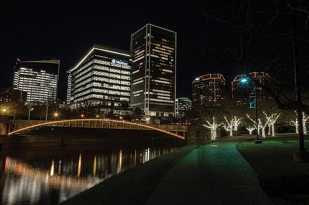 Richmond's skyline comes to life during the holiday season, with the glow of lights embracing Downtown and the riverfront. The seasonal lighting officially got underway Friday, Dec. 4, with RVA Illuminates. That's when the lights simultaneously go on after a countdown by city officials and others. Because of the pandemic, the ceremony was held virtually this year and broadcast on ABC 8News and on WRIC's website. Holiday Lights on the Riverfront, presented by Venture Richmond, followed, with decorative lights going on at Brown's Island to the Turning Basin on the Canal Walk. Entertainers and hot beverages also are a part of the riverfront celebration, which will continue from 6 to 8 p.m. Saturday, Dec. 12 and Dec. 19. People are asked to wear masks and to practice social distancing. This photograph of the Downtown skyline was taken from Brown's Island.
