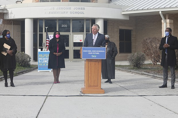 Former Gov. Terry McAuliffe, center, vows to raise teacher pay as he launches his campaign Wednesday outside Miles Jones Elementary School in South Side. Joining him are, from left, Richmond educator Dr. Milondra b. Coleman, Virginia House Majority Leader Charniele L. Herring of Alexandria, state Senate President Pro Tempore L. Louise Lucas of Portsmouth and Mayor Levar M. Stoney.