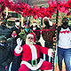 Little Hearts United, an organization that supports children who have lost loved ones to violence held a Coat-Give-A-Way at 1400 Greenmount Avenue in Baltimore on Saturday, December 5, 2020. (Above) Santa Claus (Dick Bissell) is seated at center. To his left are Donny Moses (kneeling); Jerrod Murray; and Santa's Helper (Susan Fleshman). Pictured in the back row are Rashida Murray; Baltimore City Fire Chief Niles R. Ford; Olivia Millspaugh; Will Brown; Millie Brown; and Faith Millspaugh.