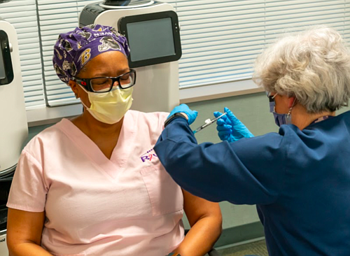 Sharon Henry, MD, a Professor of Surgery at the University of Maryland School of Medicine, receiving her first dose of the vaccine.