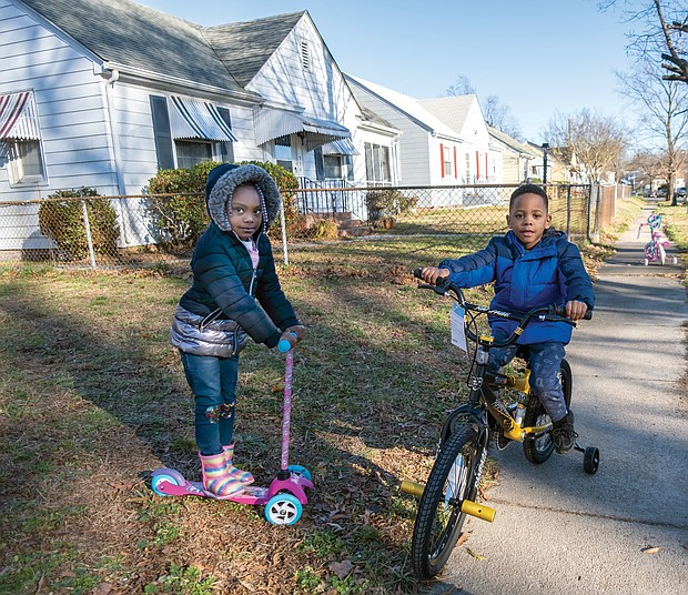Gani brown, 4, and her older brother, Thi'yon Everhart, 5, try out their new wheels the day after Christmas near their grandmother's house in the 500 block of Milton Avenue in North Side. More good weather for outdoor activities is expected before and after New Year's Day, with temperatures expected to climb into the 60s on Saturday after rain showers on Jan. 1.