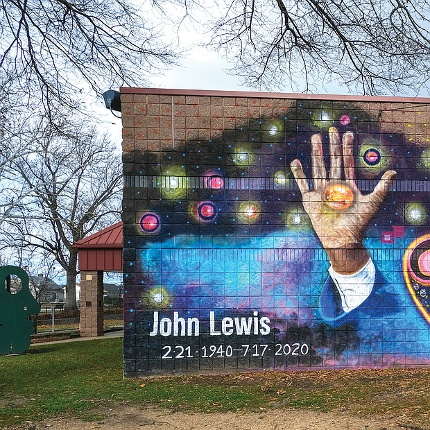 """This mural of the late Georgia Congressman John R. Lewis in Fulton Hill embodies the hope that he will continue to serve as an inspiration for new generations of Richmonders.  Location: Powhatan Community Center off Williamsburg Road in Fulton Hill. This tribute painting is the creation of artist Joshua Adam Zarambo. Before his death in July, Congressman Lewis earned recognition as a warrior for democratic values and human rights. As a young civil rights activist, he fought to end the oppression of Black people. He received national attention after Alabama state troopers nearly beat him to death in March 1965 while leading a peaceful march in Selma, Alabama, protesting the exclusion of Black people from voting. The agony he and others suffered led to passage of the federal Voting Rights Act. Fearless and outspoken, he was described as the """"conscience of Congress"""" during the 33 years he represented Atlanta in the U.S. House of Representatives."""