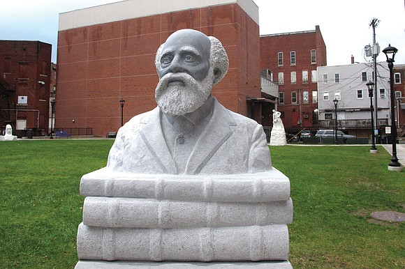 The first Black president of an American college is being honored with a sculpture installed in the Vermont city where ...