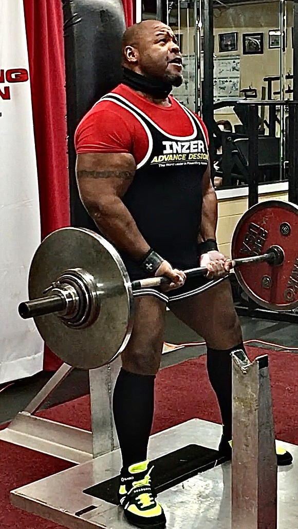 Baron Dixon fits the image of a weight-lifting champion with arms like tree trunks, legs thick as courthouse pillars and ...