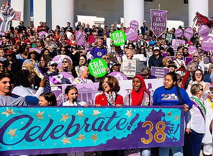 Hundreds of women and their supporters, including First Lady Pam Northam, center, celebrate Virginia becoming the 38th state to ratify the Equal Rights Amendment. The celebration included a rally, speakers and a march from Monroe Park to the Capitol on March 8, International Women's Day.