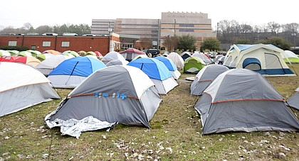 """Dozens of tents house the homeless at """"Cathy's Camp,"""" a tent city that sprang up adjacent to the city's winter overflow shelter and across the street from the Richmond Justice Center on Oliver Hill Way. The city razed the encampment in late March, moving people to area hotels during the COVID-19 crisis."""
