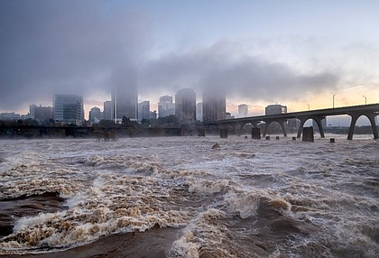 The James River, swollen and roaring after two days of heavy rain in mid-November, rolls through Richmond. The river reached its highest levels in two decades, cresting near 18 feet on Nov. 13 and 14 in Downtown. Two of the gates in the city's floodwall were closed for the first time since 1999 to protect Shockoe Bottom.