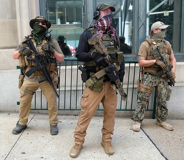 Armed members of private militia groups advocate for gun rights near the State Capitol on Aug. 18 before marching to the Siegel Center on Broad Street where the House of Delegates was meeting during a special General Assembly session to take up police reform, criminal justice reform and budget measures.