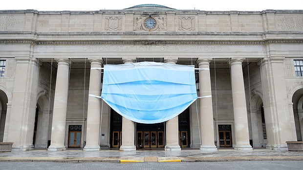 A giant mask adorns the façade of the Science Museum of Virginia at 2500 W. Broad St. as it prepared to reopen to the public on Sept. 5 after being closed for months because of COVID-19. The mask also was a visual reminder that visitors are required to wear masks to enter. The museum is one of many cultural spaces incorporating new requirements because of the pandemic.