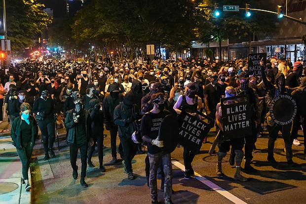 About 1,000 protesters march through Richmond to show solidarity with demonstrators in Portland, Ore., where federal officials used questionable force to detain or arrest people.