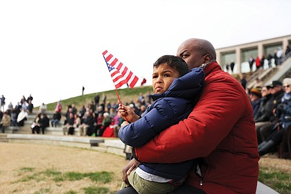 Antoine Ransom and his 4-year-old son, Mason, attend the Feb. 29 dedication of the expansion of the Shrine of Memory and grand opening of the C. Kenneth Wright Pavilion at the Virginia War Memorial in Downtown that pays tribute to Virginians who died in various wars. Mr. Ransom's cousin, Air Force Maj. Charles A. Ransom of Midlothian, was killed in Kabul, Afghanistan, during Operation Enduring Freedom in 2011.
